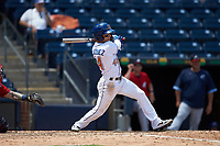 Andrew Velazquez (44) of the Durham Bulls follows through on his swing against the Columbus Clippers at Durham Bulls Athletic Park on June 1, 2019 in Durham, North Carolina. The Bulls defeated the Clippers 11-5 in game one of a doubleheader. (Brian Westerholt/Four Seam Images)