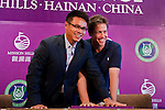 HAIKOU, CHINA - OCTOBER 28:  Dr. Ken Chu (L), Vice Chairman of Mission Hills Group helps Hollywood actor Hugh Grant of Great Britain to impresses his handprints during a press conference as part of the Mission Hills Star Trophy on October 28, 2010 in Haikou, China. The Mission Hills Star Trophy is Asia's leading leisure liflestyle event and features Hollywood celebrities and international golf stars. Photo by Victor Fraile / The Power of Sport Images