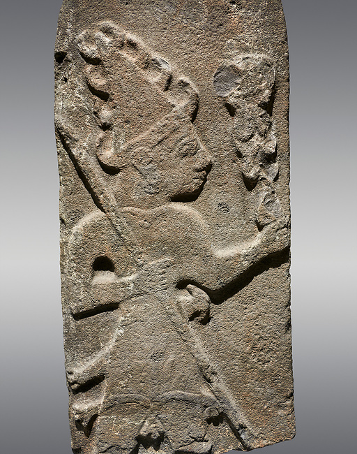 Hittite monumental relief sculpture ofa God probably holding lightning rods. Late Hittite Period - 900-700 BC. Adana Archaeology Museum, Turkey. Against a grey background