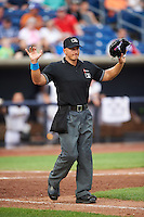 Umpire Brandin Sheeler calls foul ball during a game between the Bowing Green Hot Rods and Quad Cities River Bandits on July 24, 2016 at Modern Woodmen Park in Davenport, Iowa.  Quad Cities defeated Bowling Green 6-5.  (Mike Janes/Four Seam Images)