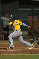 AZL Athletics first baseman Alonzo Medina (12) follows through on his swing during an Arizona League game against the AZL Giants Black at the San Francisco Giants Training Complex on June 19, 2018 in Scottsdale, Arizona. AZL Athletics defeated AZL Giants Black 8-3. (Zachary Lucy/Four Seam Images)