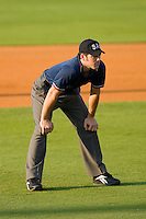 Umpire Matt Moisan handles the calls on the bases during the South Atlantic League game between the Augusta GreenJackets and the Kannapolis Intimidators at Fieldcrest Cannon Stadium July 25, 2009 in Kannapolis, North Carolina. (Photo by Brian Westerholt / Four Seam Images)