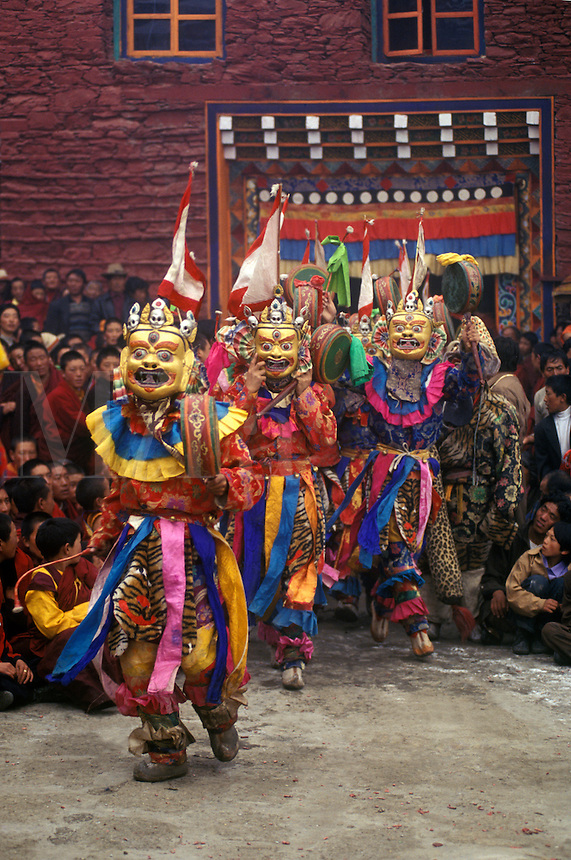 Masked dancers with skulls representing impermanence at the Cham dances, Katok Monastery - Kham, (Tibet), Sichuan, China