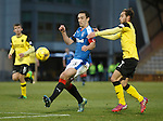 Scott Pittman grapples with Lee Wallace on the edge of the box