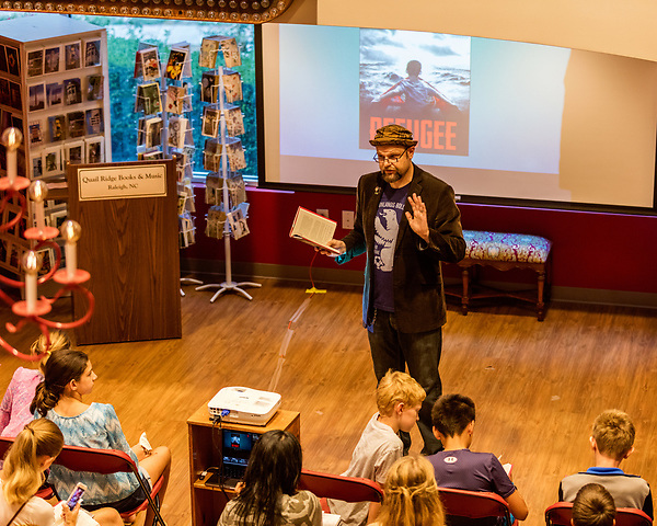 """July 26, 2017. Raleigh, North Carolina.<br /> <br /> Alan Gratz reads from his new book """"Refugee"""".<br /> <br /> Author Alan Gratz spoke about and signed his new book """"Refugee"""" at Quail Ridge Books. The young adult fiction novel contrasts the stories of three refugees from different time periods, a Jewish boy in 1930's Germany , a Cuban girl in 1994 and a Syrian boy in 2015."""