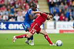 St Johnstone v Aberdeen...21.08.10  .Paul Hartley holds of Cleveland Taylor.Picture by Graeme Hart..Copyright Perthshire Picture Agency.Tel: 01738 623350  Mobile: 07990 594431