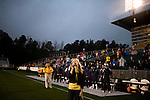 """March 14, 2009. Cary, NC.. The Carolina Railhawks went home in foul weather with a  1-0 victory over the New England Revolution of the MLS, in the inaugural """"Community Shield"""" match and their first professional outing under new coach, Martin Rennie. . Danielle Fernandez sings the National Anthem."""