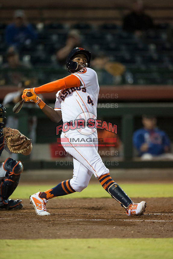 Scottsdale Scorpions center fielder Ronnie Dawson (4), of the Houston Astros organization, follows through on his swing during an Arizona Fall League game against the Mesa Solar Sox on October 9, 2018 at Scottsdale Stadium in Scottsdale, Arizona. The Solar Sox defeated the Scorpions 4-3. (Zachary Lucy/Four Seam Images)