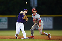 Daniel Walsh (19) of the Western Carolina Catamounts makes a throw to first after forcing out Jake Lazzaro (7) of the St. John's Red Storm at second base at Childress Field on March 12, 2021 in Cullowhee, North Carolina. (Brian Westerholt/Four Seam Images)