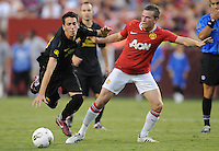 FC Barcelona forward Isaac Cuenca (29) gets fouled by Manchester United midfielder Tom Cleverly (35) Manchester United defeated Barcelona FC 2-1 at FedEx Field in Landover, MD Saturday July 30, 2011.