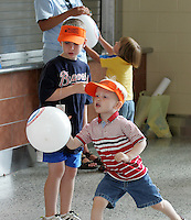children play John Paul Jones arena opened to the public 7-22-06. Photo/Andrew Shurtleff