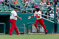 Fresno Grizzlies outfielder Yadiel Hernandez (13) is congratulated by hitting coach Brian Daubach (23) after hitting a home run during a game against the Reno Aces at Chukchansi Park on April 8, 2019 in Fresno, California. Fresno defeated Reno 7-6. (Zachary Lucy/Four Seam Images)