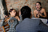 Ceci (right) gets into a fight with her boss at a restaurant in the El Caminito area of Buenos Aires where she works as a tango dancer. Ceci is in trouble because she was late. She was late because she was at school.