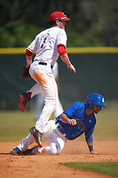Ohio State Buckeyes shortstop Craig Nennig (7) jumps over a sliding Rob Dadona (1) after throwing to first base during a game against the Seton Hall Pirates on March 4, 2016 at North Charlotte Regional Park in Port Charlotte, Florida.  Ohio State defeated Seton Hall 9-3.  (Mike Janes/Four Seam Images)