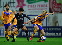 Lincoln City's Jamie Soule vies for possession with Mansfield Town's Aaron O'Driscoll<br /> <br /> Photographer Andrew Vaughan/CameraSport<br /> <br /> EFL Trophy Northern Section Group E - Mansfield Town v Lincoln City - Tuesday 6th October 2020 - Field Mill - Mansfield  <br />  <br /> World Copyright © 2020 CameraSport. All rights reserved. 43 Linden Ave. Countesthorpe. Leicester. England. LE8 5PG - Tel: +44 (0) 116 277 4147 - admin@camerasport.com - www.camerasport.com