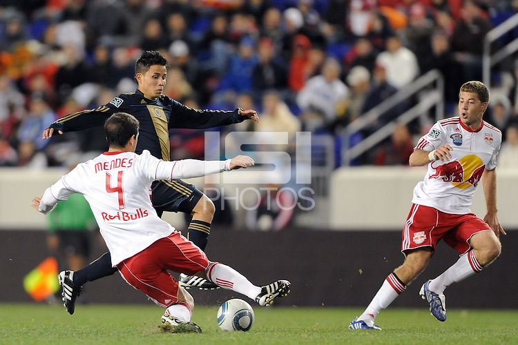 Roger Torres (20) of the Philadelphia Union is challenged by Carlos Mendes (4) of the New York Red Bulls. The New York Red Bulls defeated the Philadelphia Union 2-1 during a US Open Cup qualifier at Red Bull Arena in Harrison, NJ, on April 27, 2010.