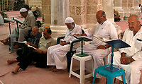 """Palestinians  reads the Koran in al-Omari mosque on the first day of Muslim fasting month of Ramadan in Gaza September 15, 2007.""""photo by Fady adwan"""""""