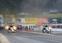 Sep 14, 2019; Mohnton, PA, USA; NHRA top fuel driver Brittany Force (left) sets a national record with an elapsed time of 3.623 seconds alongside Leah Pritchett during qualifying for the Reading Nationals at Maple Grove Raceway. Mandatory Credit: Mark J. Rebilas-USA TODAY Sports