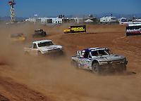 Apr 17, 2011; Surprise, AZ USA; LOORRS driver Travis Coyne (5) leads Carl Renezeder (17) during round 4 at Speedworld Off Road Park. Mandatory Credit: Mark J. Rebilas-