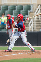 Jose Marmolejos-Diaz (6) of the Hagerstown Suns follows through on his swing against the Kannapolis Intimidators at CMC-Northeast Stadium on August 16, 2015 in Kannapolis, North Carolina.  The Suns defeated the Intimidators 7-2 in game one of a double-header.  (Brian Westerholt/Four Seam Images)