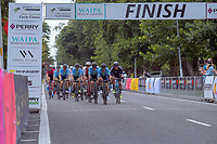 The peloton passes the finish line on the first lap. Stage One - Lost Lake Loop (Cambridge - Kaipaki - Roto O Rangi - Leamington). 2019 Grassroots Trust NZ Cycle Classic UCI 2.2 Tour from St Peter's School in Cambridge, New Zealand on Wednesday, 23 January 2019. Photo: Dave Lintott / lintottphoto.co.nz