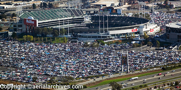 aerial photograph of a full parking lot of fans tailgating at the Oakland Coliseum, Oakland, California prior to an Oakland Raiders football game