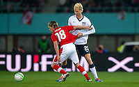 VIENNA, Austria - November 19, 2013: Brek Shea and Austria's Christoph Leitgeb during a 0-1 loss to host Austria during the international friendly match between Austria and the USA at Ernst-Happel-Stadium.