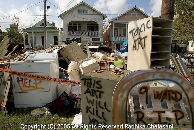St. Claude, New Orleans-October 01: An artistic statement about the death of the lower ninth ward on exhibition October 01, 2005 in St. Claude after Hurricane Katrina struck. The lower 9th Ward, one of the poorest sections of the city, was flooded when the levees failed to hold after Katrina struck. The question of whether the 9th Ward will be rebuilt has touched on sensitive issues of race and class in the city since many of residents were poor and black. The art is made from the contents of Andrea Garland and Jeffrey Holmes' home in St. Claude after it was flooded by three feet of water. (Photo By Radhika Chalasani/Getty Images)