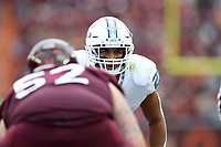 BLACKSBURG, VA - OCTOBER 19: Chazz Surratt #21 of the University of North Carolina looks over the line of scrimmage during a game between North Carolina and Virginia Tech at Lane Stadium on October 19, 2019 in Blacksburg, Virginia.