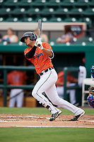 Lakeland Flying Tigers right fielder Elvis Rubio (20) follows through on a swing during the second game of a doubleheader against the St. Lucie Mets on June 10, 2017 at Joker Marchant Stadium in Lakeland, Florida.  Lakeland defeated St. Lucie 9-1.  (Mike Janes/Four Seam Images)