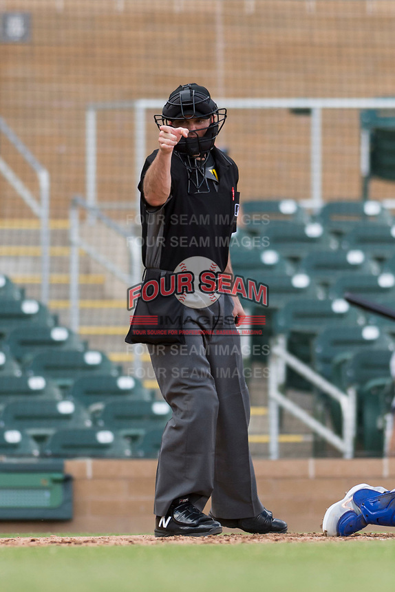 Home plate umpire Blake Carnahan calls a strike during an Arizona Fall League game between the Surprise Saguaros and the Salt River Rafters at Salt River Fields at Talking Stick on October 23, 2018 in Scottsdale, Arizona. Salt River defeated Surprise 7-5 . (Zachary Lucy/Four Seam Images)