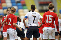Shannon Boxx, captain of the US National Team, stands tough in a group of Norwegian players during the 2010 Algarve Cup.