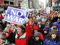 """An estimated 300,000 people took to the streets of New York City on February 15, 2003 to protest the impending U.S. led invasion of Iraq.<br /> <br /> Protests were held worldwide in what turned out to be the largest coordinated ant-war protest in history, with an estimated 6-20 million people demonstrating in 800 cities across the world that day.<br /> <br /> The conception of the mass protest is attributed to several """"anti-globalist"""" European organizations, and was taken up swiftly in the United States, most notably by the """"United for Peace and Justice"""" organization.  While the most heavily attended protests occurred in Europe (with some 3 million people flocking to the streets of Rome and 1 million in London) protests in the United States were well attended also.  In New York City the day was marked with a heavy police presence as people were penned in by various barricades from block to block, not allowing the vast majority of them to reach the final protest staging area and effectively cutting the huge crowd off from itself.  There were also many reports of police abuse and unnecessary arrests.<br /> <br /> Although the coordination and scope of the protests was unprecedented, the response of the US government was underwhelming and ultimately demoralizing to the movement- on March 20, 2003, the invasion of Iraq began.  From that point, mass protests attracted fewer and fewer people as many felt that their voices were indeed being heard but ultimately ignored."""