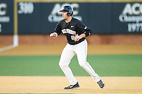 Will Craig (22) of the Wake Forest Demon Deacons takes his lead off of second base against the Georgetown Hoyas at Wake Forest Baseball Park on February 16, 2014 in Winston-Salem, North Carolina.  The Demon Deacons defeated the Hoyas 3-2.  (Brian Westerholt/Four Seam Images)