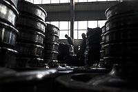 Workers stand among stacks of train carriage wheels at Ma Steel in Maanshan, China. With an additional plant that opened last year, Ma Steel is the world's largest producer of train carriage wheels with an annual capacity of 1.1 million units..29 Dec 2008