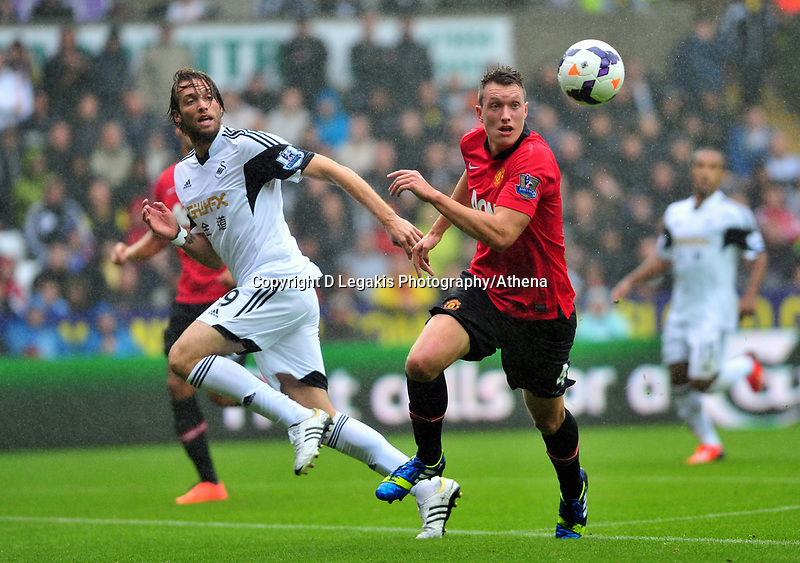 Manchester United's Phil Jones on the ball.<br /> Saturday 17 August 2013<br /> Pictured: <br /> Re: Barclays Premier League Swansea City v Manchester United at the Liberty Stadium, Swansea, Wales