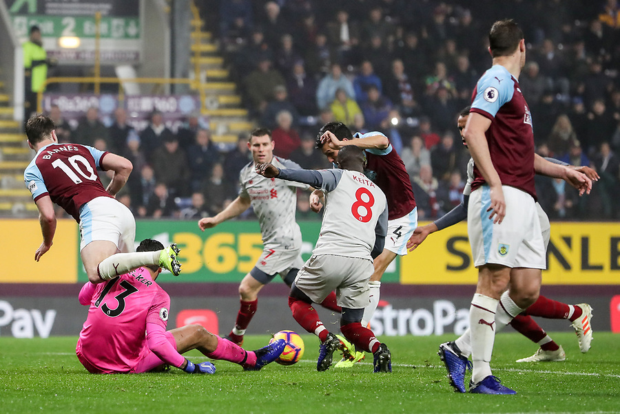 Burnley's Jack Cork scoring his side's first goal under pressure from Liverpool's Naby Keita<br /> <br /> Photographer Andrew Kearns/CameraSport<br /> <br /> The Premier League - Burnley v Liverpool - Wednesday 5th December 2018 - Turf Moor - Burnley<br /> <br /> World Copyright © 2018 CameraSport. All rights reserved. 43 Linden Ave. Countesthorpe. Leicester. England. LE8 5PG - Tel: +44 (0) 116 277 4147 - admin@camerasport.com - www.camerasport.com