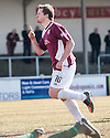 Arbroath's Steven Doris celebrates after he scores their equalising first goal from the spot.