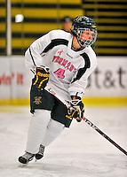 29 January 2012: University of Vermont Catamount defenseman Greer Vogl, a Freshman from Edina, MN, in action against the University of New Hampshire Wildcats at Gutterson Fieldhouse in Burlington, Vermont. The Lady Cats, dressed in their Breast Cancer Awareness jerseys, edged out the Wildcats 2-1 to split their Hockey East twin-game weekend series. Mandatory Credit: Ed Wolfstein Photo