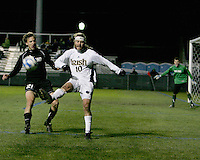 Joseph Lapira #10 of Notre Dame kicks the ball away from Ian Daniel #21 of Oakland. The University of Notre Dame defeated Oakland University 2-1 in the second round of the NCAA championship at Alumni Field at the University of Notre Dame in South Bend, Indiana on November 28, 2007.