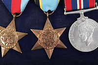 BNPS.co.uk (01202) 558833. <br /> Pic: C&TAuctions/BNPS<br /> <br /> Pictured: The medal set awarded to Flight Sergeant Eric Redfern.  <br /> <br /> The poignant archive of a tragic Battle of Britain hero has been discovered in a suitcase.<br /> <br /> Flight Sergeant Eric Redfern had been married to Joan Preston for a few weeks when he was shot down and killed in 1941.<br /> <br /> The 27 year old Hurricane pilot was ambushed by German fighters during a raid on enemy supply vessels at Le Touquet in northern France.