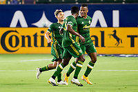 CARSON, CA - OCTOBER 07: Jeremy Ebobisse #17 of the Portland Timbers scores a goal off of a freekick and celebrate Larrys Mabiala #33 during a game between Portland Timbers and Los Angeles Galaxy at Dignity Heath Sports Park on October 07, 2020 in Carson, California.