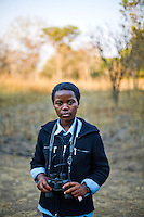 """15 year old Gweni Mwanabene, from Kafinda basic school in Sereje district, on her first safari in Kasanka National Park. """"Some parents think that National Parks are there because the people are involved in protecting animals are somehow selfish and don't want to share the animals in terms of meat with the others outside the national parks. If people kill the animals in the NP there won't be any left. It stops our country's development because animals are a source of tourist attractions."""" Local schools and women's groups are regularly brought into Kasanka, which is unique in the country and unusual in Africa as it is privately managed and owned by a trust. People are able to see animals flourishing in land which was once free reign for poachers. Combined with anti-poaching scouts, the education programme is on the frontline of conservation methods in the park, showing local people wild animals in their natural habitat."""