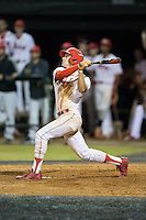Matt McGarry (1) of the Belmont Abbey Crusaders follows through on his swing against the Catawba Indians at Abbey Yard on February 7, 2017 in Belmont, North Carolina.  The Crusaders defeated the Indians 12-9.  (Brian Westerholt/Four Seam Images)