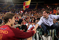 Calcio, Serie A: Roma-Catania. Roma, stadio Olimpico, 5 maggio 2012..Football, Italian serie A: AS Roma vs Catania. Rome, Olympic stadium, 5 may 2012..AS Roma captain Francesco Totti shakes hands with a fan at the end of the match..UPDATE IMAGES PRESS/Riccardo De Luca