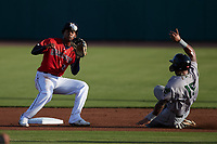 Abiezel Ramirez (2) of the Charleston RiverDogs waits for a throw as Willie Carter (15) of the Augusta GreenJackets slides into second base at Joseph P. Riley, Jr. Park on June 25, 2021 in Charleston, South Carolina. (Brian Westerholt/Four Seam Images)
