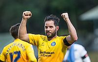 Sam Wood of Wycombe Wanderers punches the air on the final whistle during the FA Cup 1st Round match between FC Halifax Town and Wycombe Wanderers at The Shay Stadium, Shaw Hill, Halifax, West Yorkshire, England on 8 November 2015. Photo by Andy Rowland.