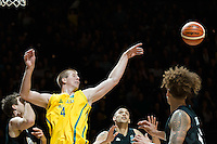 Melbourne, 15 August 2015 - Chris GOULDING of Australia jumps for the ball in game one of the 2015 FIBA Oceania Championships in men's basketball between the Australian Boomers and the New Zealand Tall Blacks at Rod Laver Arena in Melbourne, Australia. Aus def NZ 71-59. (Photo Sydney Low / sydlow.com)