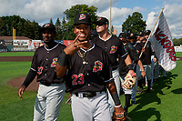 Batavia Muckdogs Nasim Nunez (23), Milton Smith II (33), Nic Ready (3) after clinching the Pinckney Division Title during a NY-Penn League game against the Auburn Doubledays on September 2, 2019 at Falcon Park in Auburn, New York.  Batavia defeated Auburn 7-0 to clinch the Pinckney Division Title.  (Mike Janes/Four Seam Images)