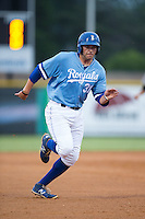 Brandon Dulin (31) of the Burlington Royals hustles towards third base against the Pulaski Yankees at Burlington Athletic Park on August 6, 2015 in Burlington, North Carolina.  The Royals defeated the Yankees 1-0. (Brian Westerholt/Four Seam Images)